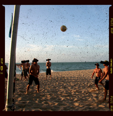 Photo of people playing beach volleyball badly