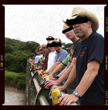 The original line up boys overlooking a bunch of bigass crocoodiles on a bridge somewhere secret