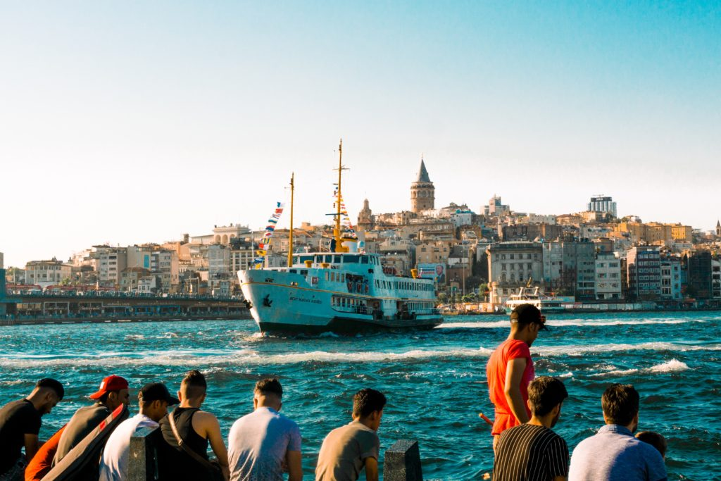 Photo of a boat with Turkey in the background