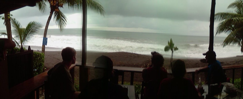 Photo of the ocean taken from a beach bar
