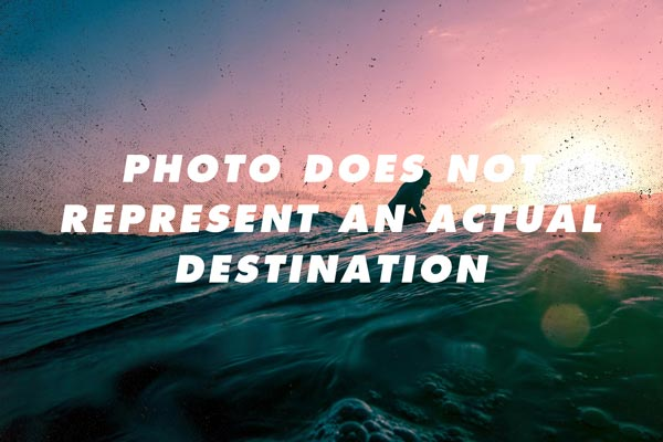 """Photo of a man surfing with the words """"Photo Does Not Represent an Actual Destination"""" on it"""